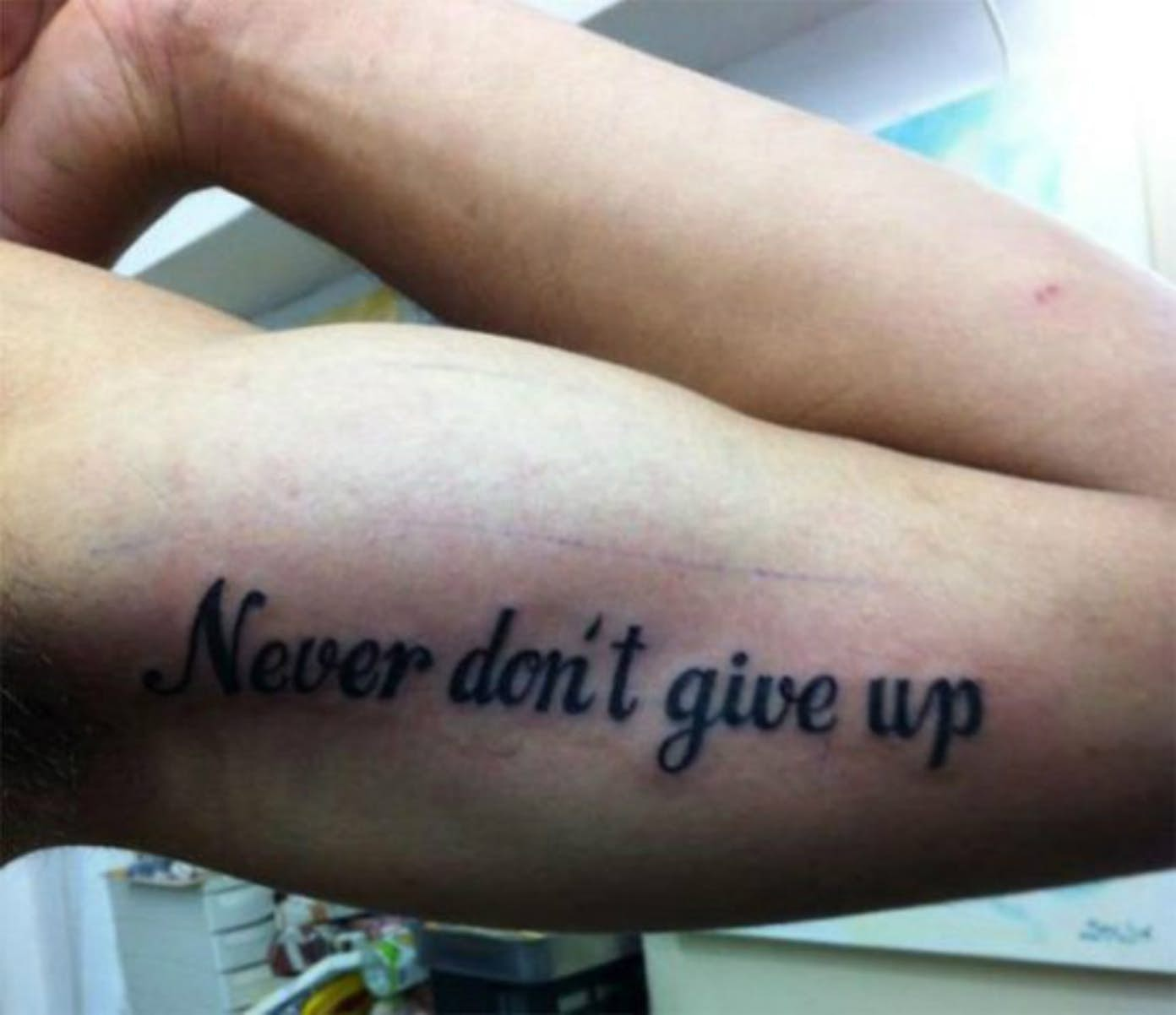 Top 13 ugliest tattoos people definitely regret getting the sentiment never give up is a good one i tell my kids not to give up all the time and i can see why someone would want that as a tattoo biocorpaavc