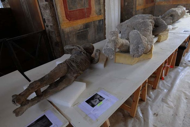 A picture shows petrified victims of the eruption of Vesuvius volcano in 79 BC, during the restoration work and the study of 86 casts in the laboratory of Pompeii Archaeological Site, on May 20, 2015 in Pompeii.   AFP PHOTO / MARIO LAPORTA        (Photo credit should read MARIO LAPORTA/AFP/Getty Images)